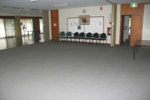 Large room with carpet and cement floors